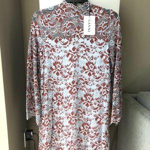 Dresses & Skirts - Ganni lace mini dress